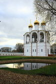 Pond that reflects the monastery bell tower standing next — Stockfoto