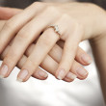 Engagement ring inserted into finger — ストック写真 #4862797