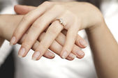 Engagement ring inserted into finger — Stock Photo