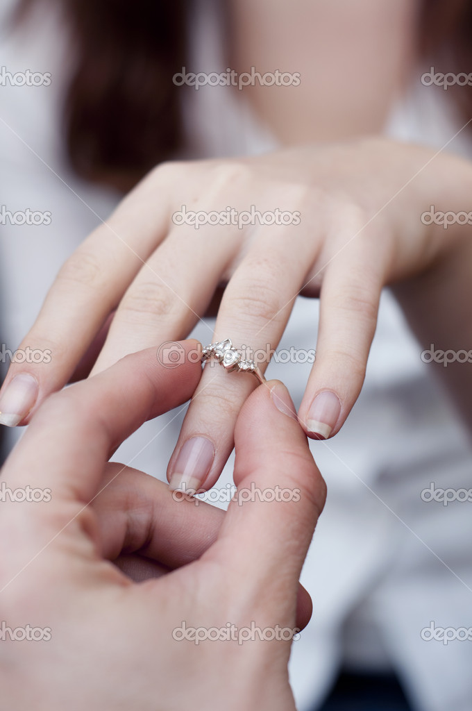 An image of situation of inserting engagement ring into a finger — Stock Photo #4862702