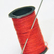 Stock Photo: Spool of thread and needle