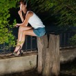 Stock Photo: Girl siting on stump