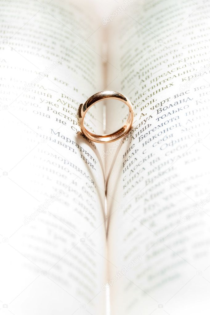 A wedding Ring in the bible with shadow of heart shape
