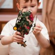 Little boy with toy helicopter — Stock Photo