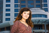 Beautiful business woman at modern building — Stock Photo