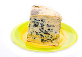Slice of french musty cheese — Stock Photo