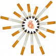 Stock Photo: Small humheart against numerous cigarettes