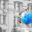 colored globe on black and white facade administrative house in — Stock Photo