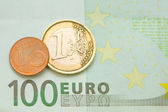 One euro, one cent on one hundred euro bill — Stock Photo