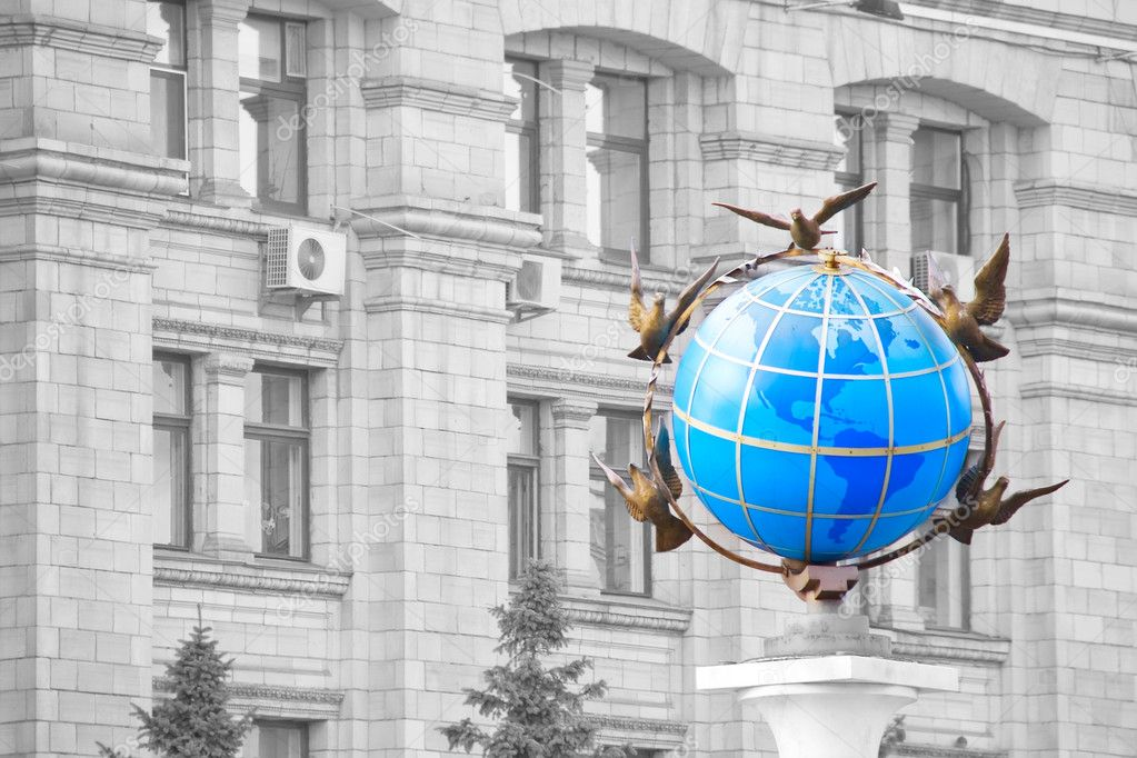 A statue of a blue terrestrial globe with doves of peace around it in Kiev, Independence square, Ukraine  Stock Photo #4191581