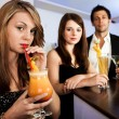 Beautiful women with friends at the bar — Stock Photo