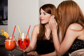 Girls talking gossips — Stock Photo