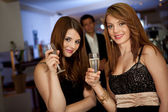 Two young women drinking chanpagne — Stock Photo