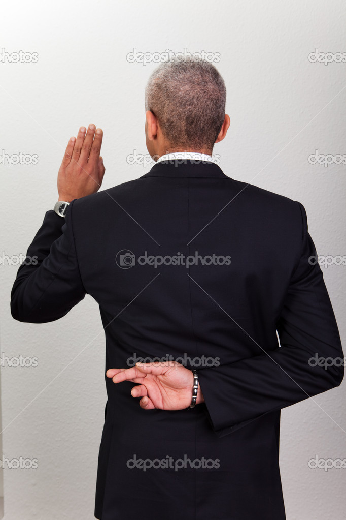 Businessman Taking Oath With Crossed Fingers. Dishonesty concept  Stock Photo #4591021