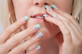 Women with acrylic fingernails — Stock Photo