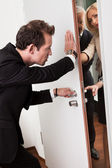 Businessman pushing the door — Stock Photo