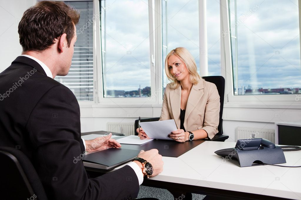 Two businesspeople at an interview in the office — Stock Photo #4641184