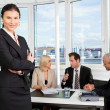 Businesswoman standing in front — Stock Photo #4669977