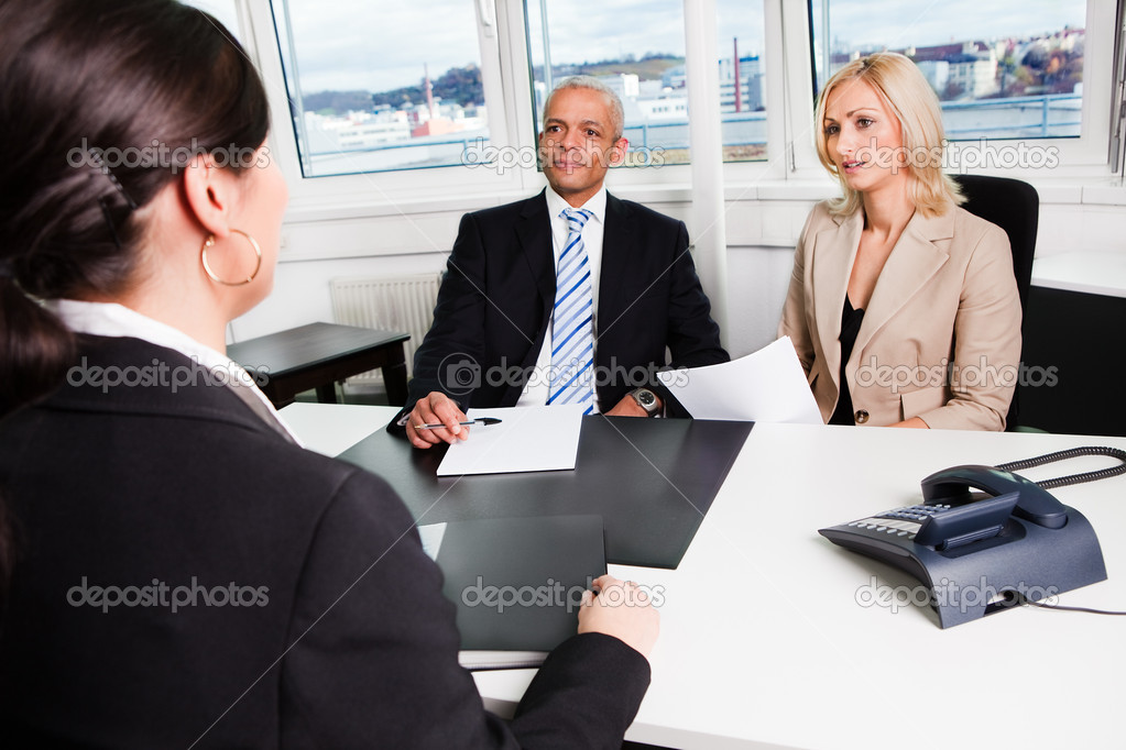 Three businesspeople at an interview in the office — Stock Photo #4669940