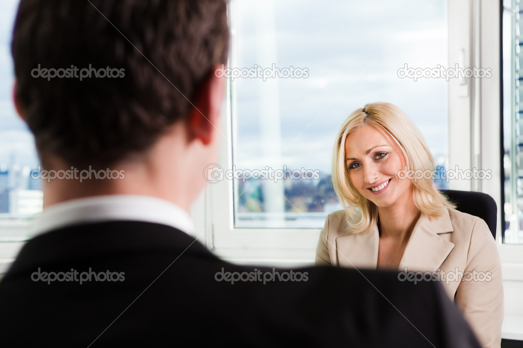 Two businesspeople at an interview in the office — Stock Photo #4669944