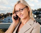 Beautiful businesswoman talking on cellphone — Stock Photo