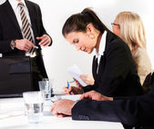 Businesswomen taking notes at the presentation — Stock Photo