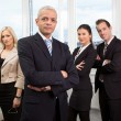 Businessman standing in front — Stock Photo #4737902