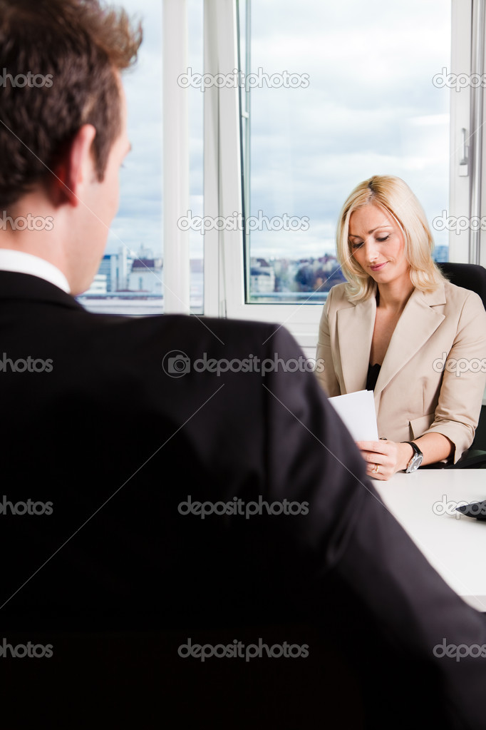 Two businesspeople at an interview in the office — Stock Photo #4737739