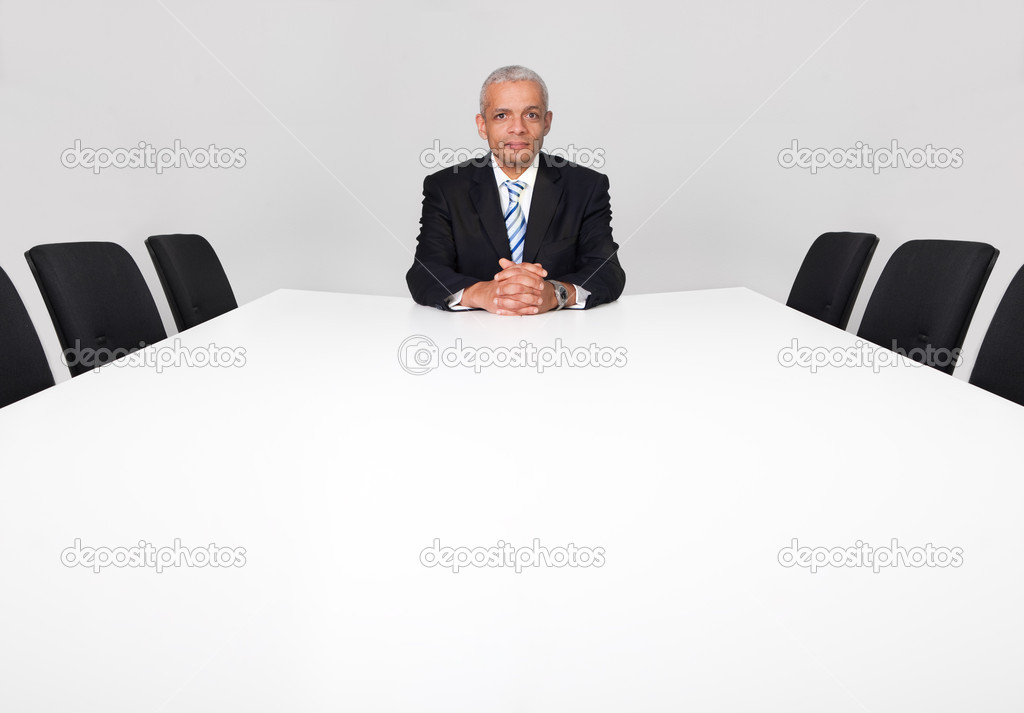 Businessman sitting alone in the empty boardroom — Stock Photo #4738230