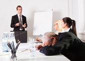Businessman sleeping at the presentation — Stock Photo