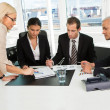 Foto Stock: Boss insctructing business team