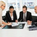 Boss insctructing business team — Stock Photo