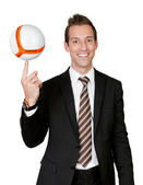 Businessman spinning soccer ball — Stock Photo