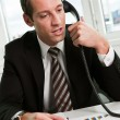 Young businessman speaking on the phone - Stock Photo