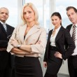 Businesswoman standing in front — Stock Photo #4874073