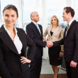 Businesswoman standing in front — Stock Photo #4874110
