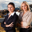Two confident businesswomen ouside - Stock Photo
