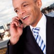 Businessman talking on cellphone outside — Stock Photo