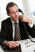 Young businessman speaking on the phone — Stock Photo