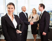 Businesswoman standing in front — Stock Photo