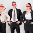 Group of disoriented businesspeople — Stock Photo