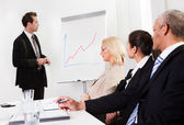 Businessman giving a presentation — Stock Photo