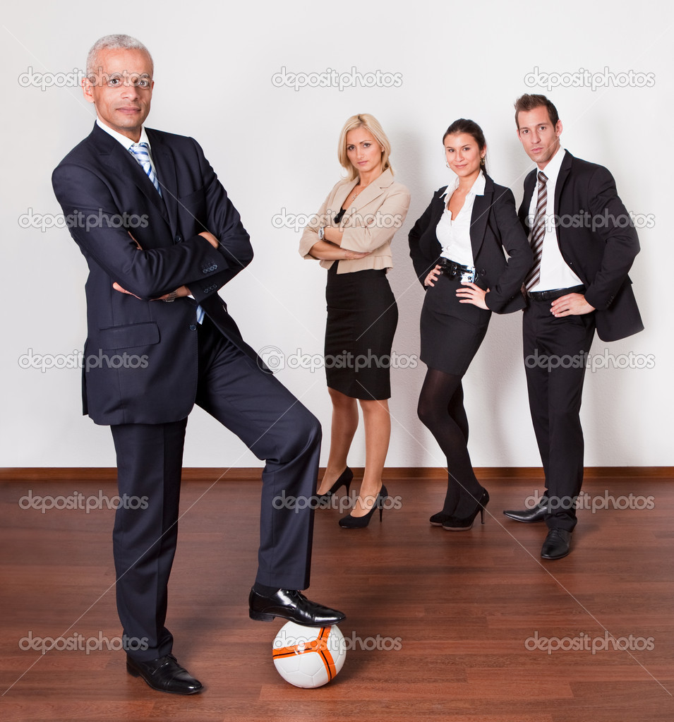 Strong professional competitive business team of four  Stock Photo #4899238
