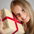 Royalty-Free Stock Photo: Happy woman holding gift box