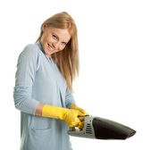 Cheerful woman with handheld vacuum cleaner — Stock Photo
