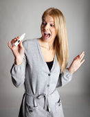 Young woman scared of pregnancy test results — Stock Photo
