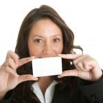 Businesswoman holding blank card — Stock Photo