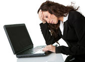 Stressful business woman working on laptop — Stok fotoğraf