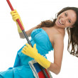 Excited woman having fun while cleaning — Stockfoto