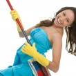 Excited woman having fun while cleaning — Stock Photo #5030945